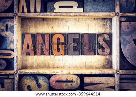 "The word ""Angels"" written in vintage wooden letterpress type."