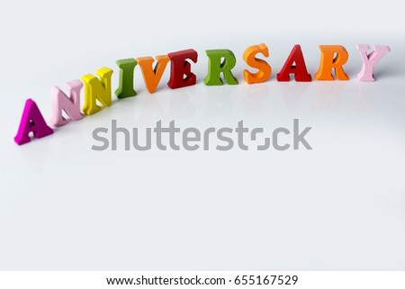 the word anniversary on the white background of colorful letters