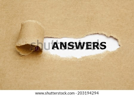The word Answers appearing behind torn brown paper. - stock photo