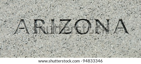 "The word ""Arizona"" carved into granite"