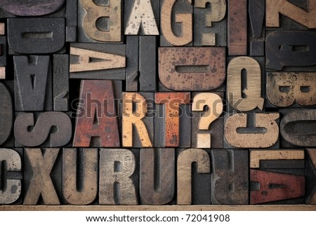 The word 'Art?' spelled out in very old letterpress blocks. - stock photo