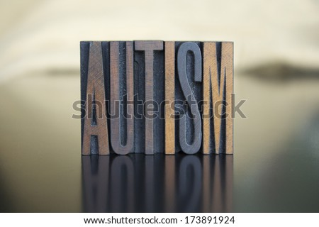 The word AUTISM written in vintage letterpress type - stock photo