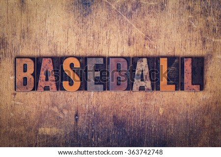 """The word """"Baseball"""" written in dirty vintage letterpress type on a aged wooden background. - stock photo"""