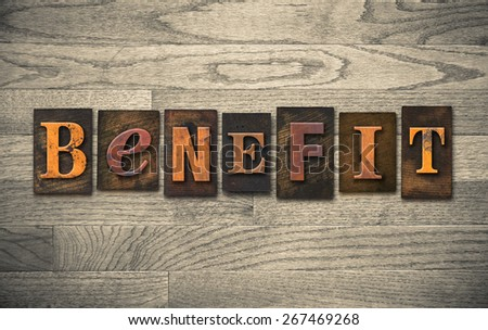 "The word ""BENEFIT"" theme written in vintage, ink stained, wooden letterpress type on a wood grained background. - stock photo"
