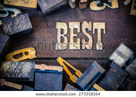 The word BEST written in rusted metal letters surrounded by vintage wooden and metal letterpress type. - stock photo