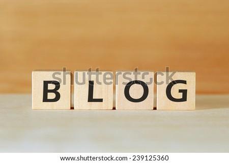 the word BLOG on wood blocks - stock photo