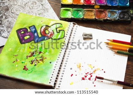 the word BLOG painted in a notebook - stock photo