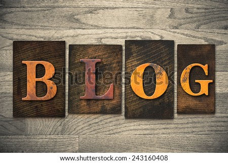 "The word ""BLOG"" written in wooden letterpress type. - stock photo"