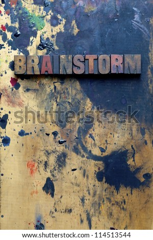 The word Brainstorm written in very old and well used letterpress type. - stock photo