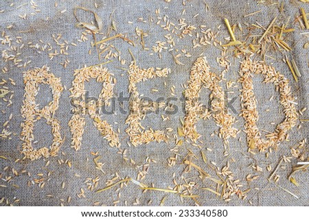 The word bread with grains of wheat close-up