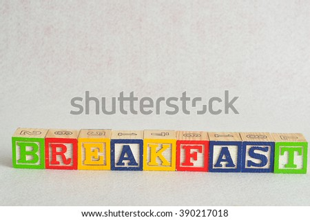 The word breakfast spelled with alphabet blocks isolated on a white background - stock photo