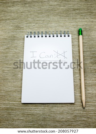 the word can't written  in pencil on a spiral bound note pad with the T crossed out to make can