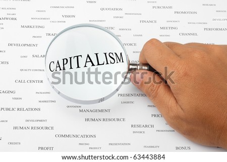 The word CAPITALISM is magnified.