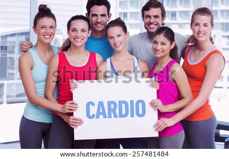 The word cardio against fit smiling people holding blank board - stock photo