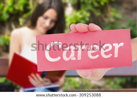 The word career and hand showing card against pretty student studying outside on campus - stock photo