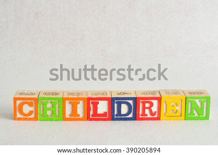 The word children spelled with colorful alphabet blocks isolated against a white background - stock photo