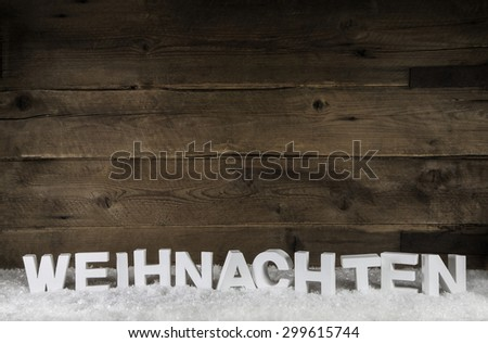 The word christmas in white german letters on wooden old rustic background. - stock photo