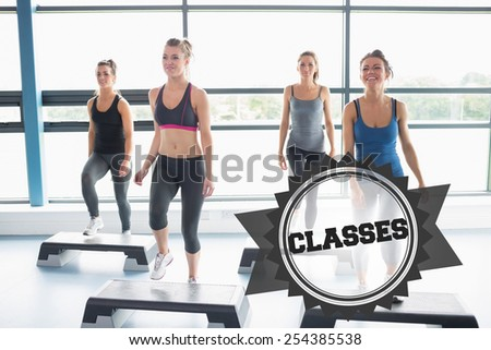 The word classes and aerobics class against badge - stock photo