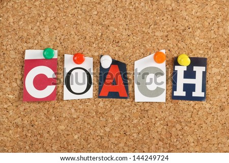 The word Coach in cut out magazine letters pinned to a cork notice board. To coach has been borrowed from sports by business to cover motivation and training for employees. - stock photo