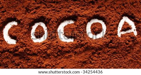 The word cocoa written in cocoa powder - stock photo