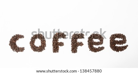 The word coffee formed with coffee beans on white background, passion for coffee