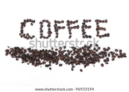 The word Coffee spelled with hundreds of coffee beans. Isolated against white background. - stock photo