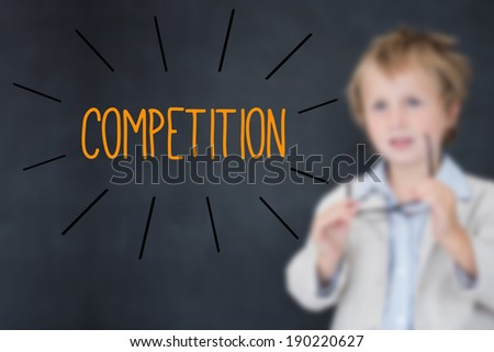 The word competition against schoolboy and blackboard