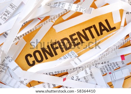 The word Confidential surrounded by some shredded papers - stock photo