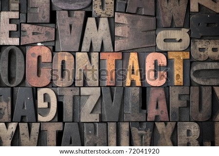 The word 'Contact' spelled out in very old letterpress blocks. - stock photo