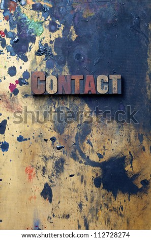 The word Contact written in antique letterpress printing blocks. - stock photo
