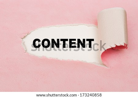 The word Content behind torn pink paper - stock photo