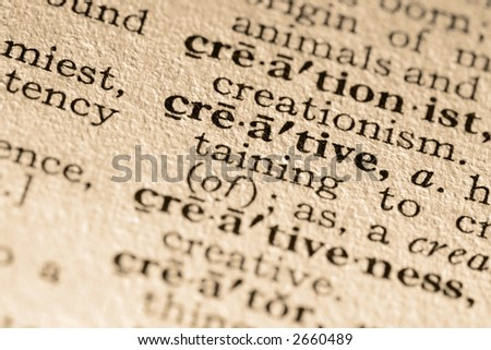 The word creative. Close-up of the word creative in a dictionary. - stock photo