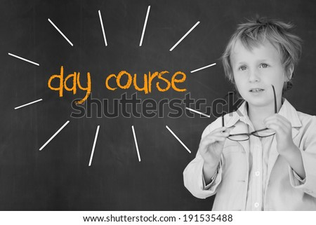 The word day course against schoolboy and blackboard - stock photo