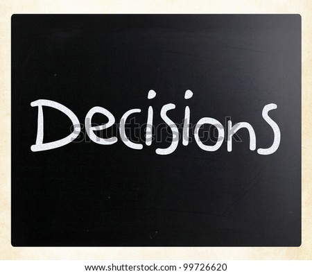 "The word ""Decisions"" handwritten with white chalk on a blackboard"