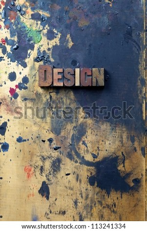 The word design written in antique letterpress printing blocks. - stock photo