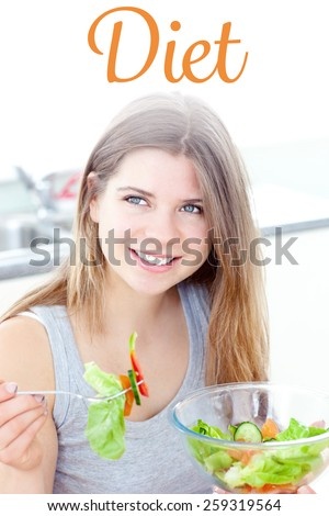 The word diet against smilling woman eating salad in the kitchen - stock photo