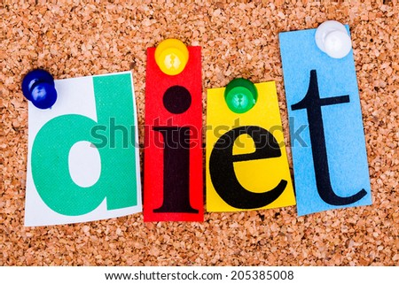 The word diet in cut out magazine letters pinned to a cork notice board - stock photo
