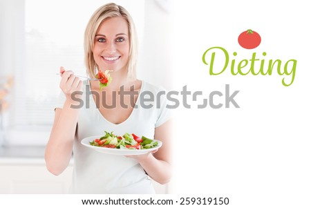 The word dieting against close up of a cute woman eating salad - stock photo