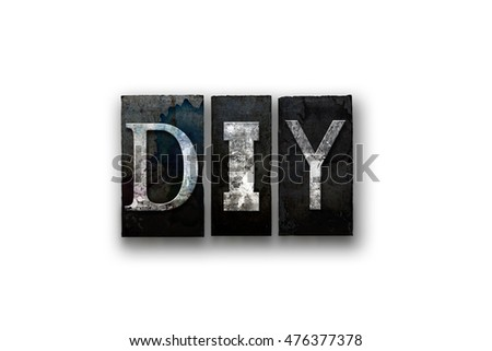 "The word ""DIY"" written in vintage, dirty, ink stained letterpress type and isolated on a white background."