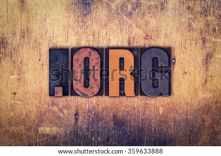 """The word """"Dot Org"""" written in dirty vintage letterpress type on a aged wooden background. - stock photo"""