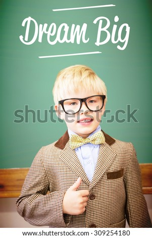 The word dream big against cute pupil dressed up as teacher in classroom - stock photo