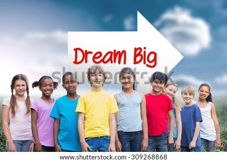 The word dream big and happy friends playing in the park against sunny landscape