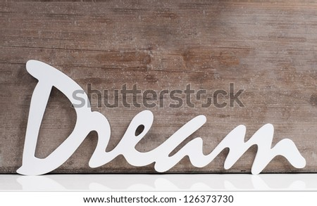 the word dream on a wooden background - stock photo