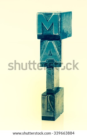 """the word """"e-mail"""" in lead letters written. photo icon for quick correspondence - stock photo"""