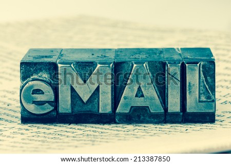 """the word """"e-mail"""" in lead letters written. symbol photo for quick correspondence - stock photo"""