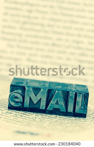 """the word """"e-mail"""" letters written in lead. photo icon for quick correspondence - stock photo"""