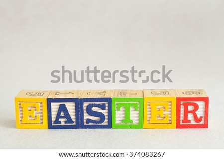 The word easter spelled with colorful alphabet blocks isolated against a white background