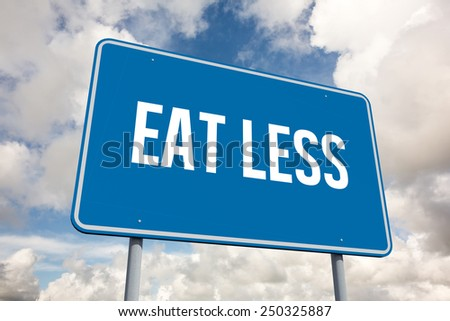 The word eat less and blue billboard against blue sky with white clouds