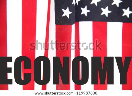 the word 'economy' on an American flag