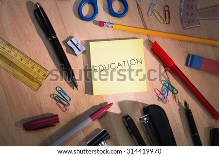 The word education against students table with school supplies - stock photo